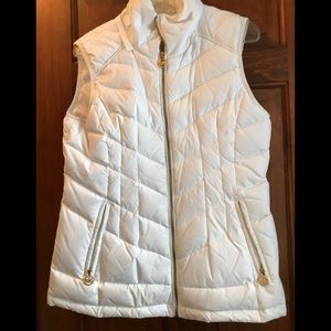 Michael Kors white puffy vest.